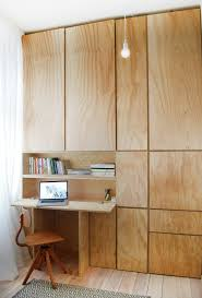 storage and office space. officenice hidden office space by the window with minimalist desk and unque storage units c