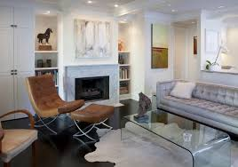 View in gallery Modern white living room with a marble fireplace