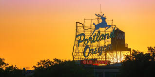 sunset over the iconic portland oregon sign in downtown portland