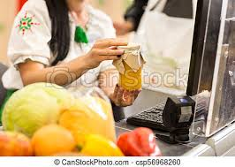 Cashier Is Working At The Supermarket