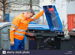 checking bin man checking rubbish bin in the street stock photos man checking