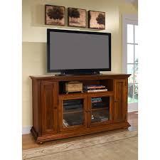 brown oak tv cabinet with doors and glass doors on the floor