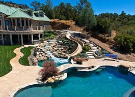 Outdoor pool with slide Gorgeous Pool And Slide And Walkways Rustic Swimming Pool With Pool With Hot Tub Built In Pool Uscupsoccerco Pool And Slide Uscupsoccerco