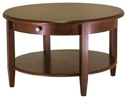 circular wood coffee table with bottom shelf and drawer