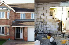 garage office conversion. the existing home before and during work on left we can see garage office conversion