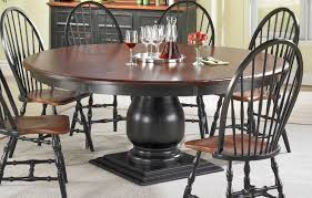 round pedestal dining table room setting black base and black cherry top
