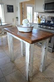rustic farmhouse style kitchen island made from reclaimed barn wood