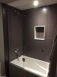 custom frameless partial bathtub enclosure barrier hinged glass to glass