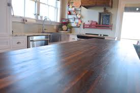 the smooth matte finish on the butcher block island with pure tung oil a