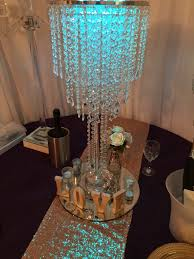 these amazing waterfall crystal style chandelier centerpieces are absolutely stunning for any event party or wedding setting the natural light of the room