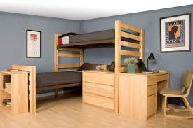 dorm room with bunk bed and wooden desk