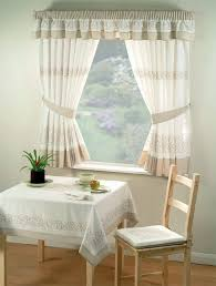 for rustic kitchens i recommend opting for kitchen curtains fabric with varnished wooden bar in natural tones and forging