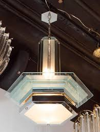 an art deco style chandelier comprising segments of hexagonal cut glass and fitted with