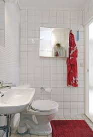 simple apartment bathroom decorating ideas. Delighful Apartment Red Mat Closed White Closet In Small Floortile Apartment Bathroom  Decorating Ideas With Simple Mirrors And A