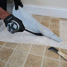 removing vinyl flooring with a prybar