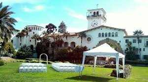 white resin chairs for wedding ceremony at santa barbara courthouse sunken gardens yelp