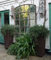 low mirrors in the garden gardenista