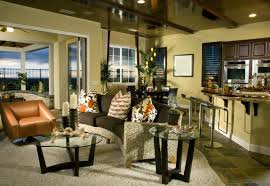 matching dining and living room furnitur. An Open Concept Living Room And Kitchen With A Dining Tucked Into The Rear Corner Matching Furnitur I