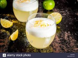 peruvian mexican chilean traditional drink pisco sour liqueur with fresh lime on