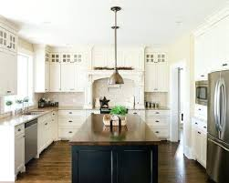 antique white kitchen cabinets with butcher block countertops off dark island top subway tile