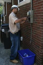 electricity meter a duke energy technician removes the tamper proof seal from an electricity meter at a residence in durham north carolina