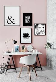 a black and white gallery wall makes this girlish space calmer and more elegant
