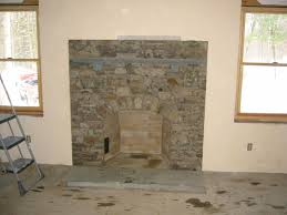 fieldstone arch fireplace