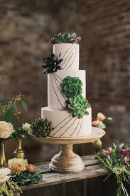 irish destination wedding inspiration · ruffled Wedding Inspiration Ireland succulent topped cakes photo by paula o'hara s ruffledblog Ireland Cliff Wedding