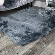 image of large grey faux fur rug wearing
