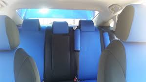 blue 2017 honda civic interior with coordinating black and blue neosupreme seat covers and seat belt pads