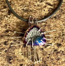 titanium coated druzy quartz zia pendant