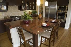 transitional kitchen remodeling riverside with kitchen island attached dining table dark brown granite countertops