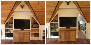 hidden wall door. basically the bookcase slides into a false wall that was built to create hidden space in an attic. linear actuator pushes and pulls door
