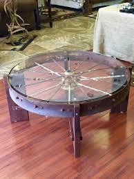 Wagon wheel coffee table Metal wagon wheel, black walnut.