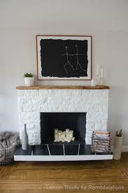 updated stone fireplace with a diy live edge wood mantel beautiful