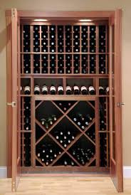 wine closet using vint wine racking components and wine cellar door installed in dover nh