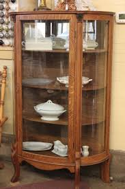 antique brown wooden display cabinets with glass doors in a small size