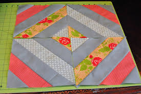 Jelly Roll Diamond Tutorial | The Aqua Umbrella & Sew your 4 block together and press. Unfinished size for this block is 17″  so in no time it creates a pretty little quilt. With a jelly roll of each  fabric ... Adamdwight.com