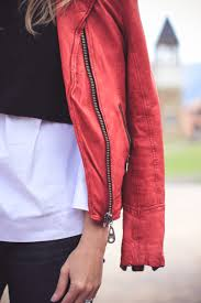 red moto jacket by doma layered over a black free people sweater vest halogen