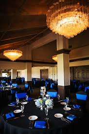Traditional Wedding Reception Dcor with Black Tablecloths, Royal Blue  Chair Covers and Napkins with Blue