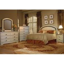Check out the contemporary Raven bedroom furniture group from