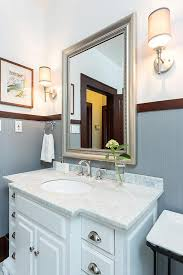 bathroom design 1920s house. trimmed walls and classic sconces - house tour bathroom design 1920s l