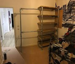 custom made reclaimed wood steel scaffold pipe shelving unit and hanging rail