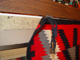even with only half of the top edge of this navajo rug rubbed into the velcro the entire weight is already being supported a small piece of velcro can