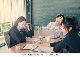 people bored at work. bored business people and sleeping resting on workplace during work meeting, concept of exhausted businesspeople at