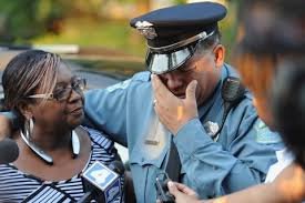 A police officer is overcome with emotion during a candlelight vigil held in honor of Jamyla Bolden on Aug     in Ferguson  Mo   Michael B  Thomas Getty     Washington Post