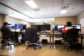 Android Developer Armando Smith, left, and Quality Assurance Engineer  Andrew Smith work at their desks at LaunchKey, a Las Vegas-based technology  company that was recently acquired by Portland, Or …   Las