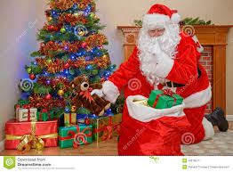 Royalty-Free Stock Photo. Download Santa Delivering Christmas Presents.
