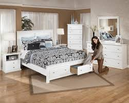modern bedroom storage solution with freestanding wooden white rectangle two drawers frame storage platform bed and freestanding wooden white square two