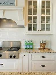 off white painted kitchen cabinets. Sherwin Williams SW6385 Dover White. Kitchen Cabinets Are Off-white Painted In A Similar Off White R